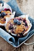 picture of cupcakes  - Homemade blueberry muffins in paper cupcake holder - JPG