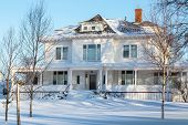 picture of blanket snow  - An older home blanketed in snow - JPG