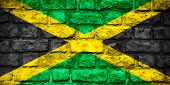 stock photo of jamaican flag  - flag of Jamaica or Jamaican banner on brick texture - JPG
