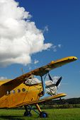 picture of biplane  - Sporting biplane aircraft prepared on the tarmac - JPG