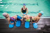 foto of swimming  - Cute swimming class and coach smiling at the leisure center - JPG