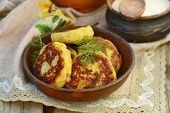 stock photo of patty-cake  - potato patties with fried bacon and onions - JPG