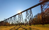 foto of trestle bridge  - The morning sun silhouettes the Tulip Trestle also know as the Greene County Viaduct one of the world - JPG