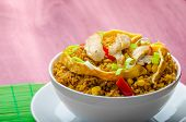 image of crispy rice  - Chicken curry rice with crispy chinese omellete chinese chopsticks - JPG