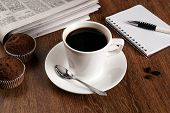 stock photo of peppy  - business still life with cup of black coffee on desktop - JPG