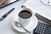 foto of peppy  - businessman running and a cup of coffee on him desktop - JPG