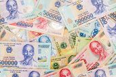 stock photo of dong  - Vietnamese money dong random spread background texture - JPG