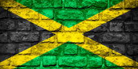 picture of jamaican flag  - flag of Jamaica or Jamaican banner on brick texture - JPG