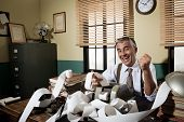 picture of cheers  - Cheerful vintage accountant surrounded by adding machine paper tape in his office - JPG
