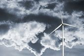 stock photo of wind-power  - wind power plant and story clouds - JPG
