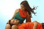 image of caress  - Happy young casual caucasian romantic couple resting with man in lap of girlfriend - JPG