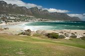 image of south-western  - Mid afternoon view of Camps Bay and Twelve Apostles range from Maidens Cove in Cape Town South Africa in the Western Cape of the country - JPG