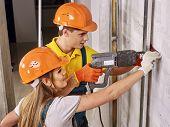 picture of millwright  - Happy family in builder uniform indoor - JPG