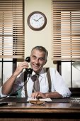 picture of 1950s  - Smiling handsome businessman on the phone working at desk 1950s vintage office - JPG