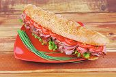 foto of french curves  - french sandwich on red plate  - JPG