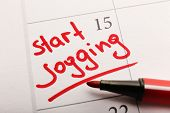 image of weekdays  - Written plan Start Jogging on calendar page background - JPG
