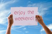 stock photo of weekdays  - Enjoy the Weekend card with sky background - JPG