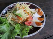 image of green papaya salad  - closed up papaya salad with salted egg