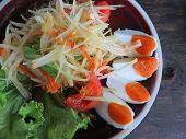picture of green papaya salad  - closed up papaya salad with salted egg - JPG