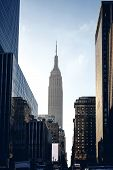 stock photo of empire state building  - Below view from street on Empire state building in New York - JPG