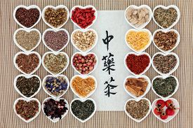 foto of chinese calligraphy  - Chinese herbal tea selection with calligraphy script on rice paper - JPG