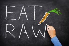 foto of vegetable food fruit  - EAT RAW words written on blackboard  - JPG
