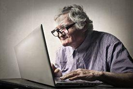 pic of ugly  - Elderly man using technology  - JPG