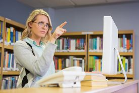 foto of librarian  - Pretty librarian working in the library at the university - JPG