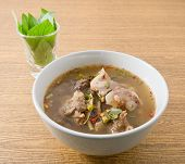picture of thai cuisine  - Thai Cuisine and Food A Bowl of Delicious Thai Clear Spicy Hot and Sour Soup with Beef Entrails - JPG