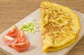 stock photo of scallion  - Thai Cuisine and Food Delicious Thai Style Omelet with Tomatoes and Chopped Scallion on A Wooden Board - JPG