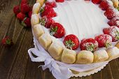 image of sponge-cake  - Delicious strawberry sponge cake Charlotte on a wooden background - JPG