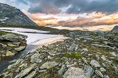 image of italian alps  - High altitude alpine lake in extreme rocky terrain and uncontaminated environment - JPG