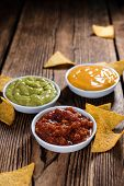 stock photo of nachos  - Three different nacho dips  - JPG