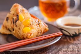stock photo of food pyramid  - Zongzi or Asian Chinese rice dumplings is a traditional Chinese food eaten during the dragon boat festival - JPG