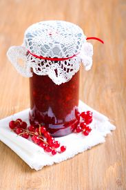 stock photo of jar jelly  - Red currant jelly sauce in a jar and spoon - JPG