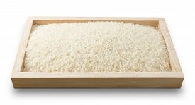picture of rice  - Cuisine and Food Uncooked White Long Rice Basmati Rice or Thai Jasmine Rice in A Wooden Tray Isolated on White Background - JPG