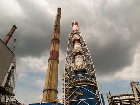 stock photo of combustion  - Various chimneys due to the different combustion technology and emission reduction - JPG