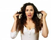 stock photo of split ends  - Isolated portrait of a beautiful young woman having a bad hair day - JPG