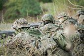 Постер, плакат: Camouflaged Army Soldiers With Guns