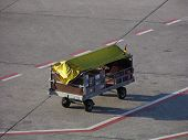 little baggage vehicle on a airport