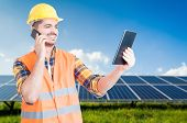 Successful Workman On Cellphone And Tablet In Hand poster