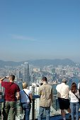 Tourists Sightseeing The Hong Kong Skyline poster