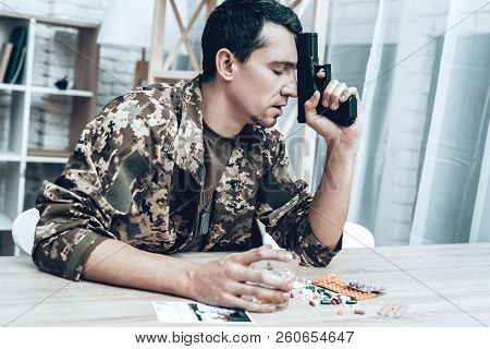 A Man In Camouflage At