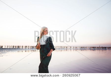Young Woman Walking On Dead