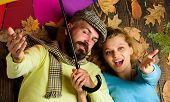 Hipster With Beard And Cheerful Girl Expect Rainy Weather Hold Colorful Umbrella. Man Bearded And Bl poster
