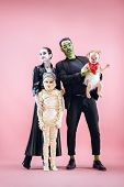 Halloween Family. Happy Father, Mother And Children Girls In Halloween Costume And Makeup. Bloody Th poster