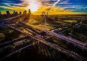 Once In A Lifetime Sun Beams At Sunrise High Above Dallas , Texas , Aerial Drone View Next To Suspen poster