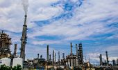 Oil Refinery Along Texas Gulf Coast With Large Smoke Stack And Massive Industrial Pollution Carbon S poster
