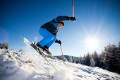 image of winter sport  - Man practicing extreme ski on sunny day - JPG