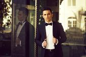 Young Man Wears Suit And Bow Tie With Confidence. Confident Businessman. poster